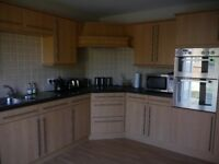 Complete used kitchen in beech with some appliances