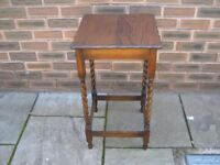 An attractive oak hall table with barley twist legs.