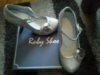 Ruby Shoo wedding shoes size 5. Silver in colour with lace trim.