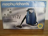 Morphy Richards compact steam cleaner.
