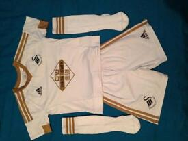 SWANSEA CITY FOOT BALL KIDS KITS FOR SALE!!!! THERS 3 SUITS HERE ONLY WORE 1 SUIT EACH TIME IMACULAT