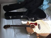 Washburn acoustic guitar with hard case and capo
