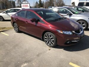 """2015 Honda Civic Touring """"it's clear to see why the Civic has..."""