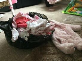 Bundle of girls clothes tiny babe and newborn