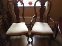 Excellent condition extendable reproduction dining table and 6 chairs, 2 carvers. Seats up to 10.