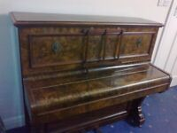 Free Lovely piano needs tuning pick up only