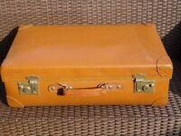 Vintage tan suitcase