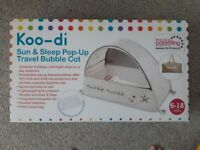 Koodi sun and pop up ttavel and sun cot. Still on box. Includes travel bag. Excellent condition.
