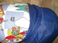 2x sleeping bags 1x patterned and 1x snakes and ladders game,