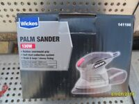 as new palm sander, with a sorted new sheets.