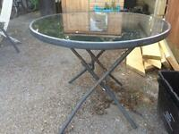 Patio table. Glass top