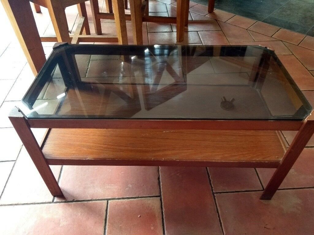 Coffee table, dark stained wood and glass top