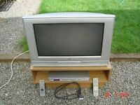 JVC 26 inch Televison plus a Panasonic DVD Player plus TV stand. Can Deliver.