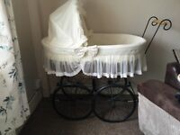 Cream antique looking crib minor damage on hood needs stitching. Good condition otherwise.