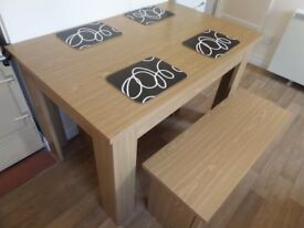 Dining table and two benches. Excellent condition.
