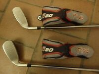 Pair of PING right-handed G20 rescue clubs.