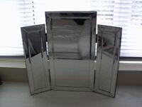 Triple bevelled mirror