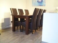 Solid dining table and 6 leather chairs