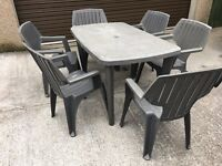 large patio table with six chairs & plastic racking & electric qualcast mower with box