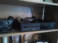 Xbox one with headset,charging station two controllers and games downloaded on it