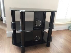 Stylish black glass John Lewis TV stand with shelf.