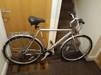 Raliegh hybrid bike with 28 inch wheel size and large frame