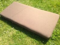 Brown single mattress