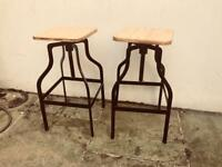 Two wood and metal kitchen bar stools