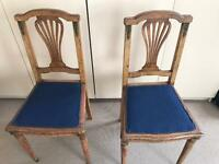 Pair of antique upholstered upright chairs