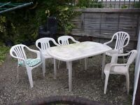 Free. White plastic garden table and 5 chairs. Buyer collect.
