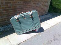 Suitcase on wheels, almost unused.