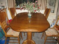 Beautiful Extending Yew Dining Table with 8 chairs.