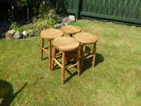 Four solid oak wooden kitchen stools