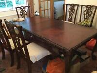 Mahogany dining table with eight chairs