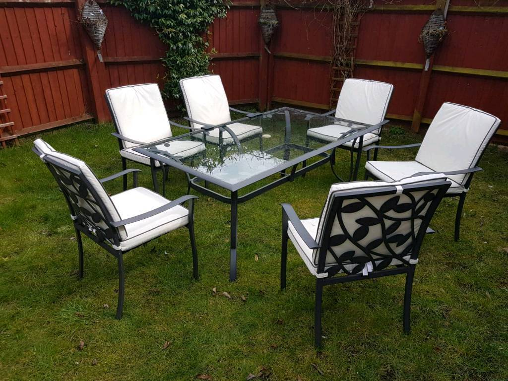 Garden table and chairs (sits 6)