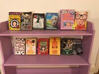 Selection of 11 girls reading books for >7. Includes Geek girl, Tracy Beaker, Marly & Me, and more