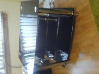 Black glass and silver tv unit.