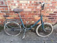 Rough old small bike - folding type - pulled out of shed