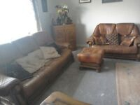 Brown leather three seater sofa, two seater sofa with matching footstool