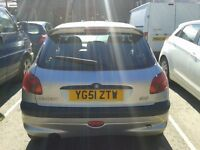 Peugeot 206, 2001. Needs new rear axle. 63,000. Other parts good for spares or save it!