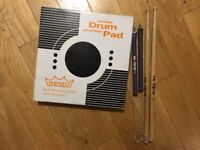"Reno 8"" Tunable Practice Pad and two sets of Vic Firth sticks"