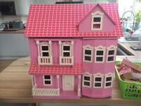 Beautiful pink dolls house