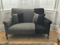 Beautiful professionally reupholstered small sofa in designers guild fabric