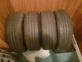 4 ALMOST NEW V/W WHEELS 195/65/15 WITH TRIMS .