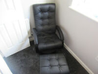 Faux black leather massage chair and footstool, hardly used and in excellent condition.