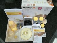 Medela Swing Electrical Breast Pump + additional Calma Solitaire and 3 x 150ml Medela Bottles