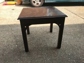 Small square dark wood coffee table