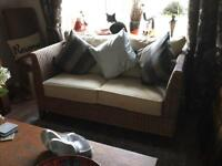 Lovely condition two seater rattan/material sofa