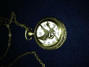Hunger Games watch necklaces