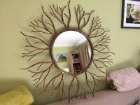 Large unusual gilt mirror